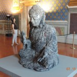 A sculptor has an exhibit with Buddha sitting across from Jesus in current Palazzo Vecchio art exhibit